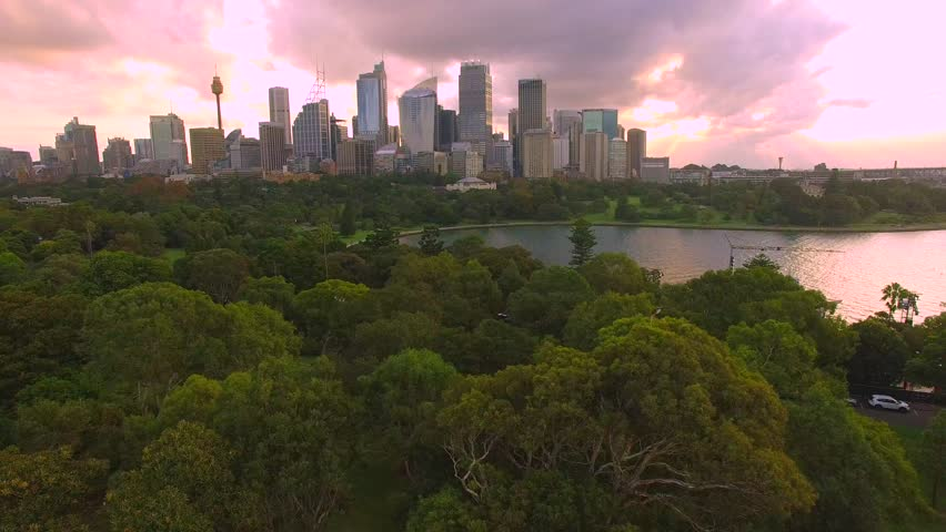 Aerial flight over Sydney Australia skyline in 4 K during sunset