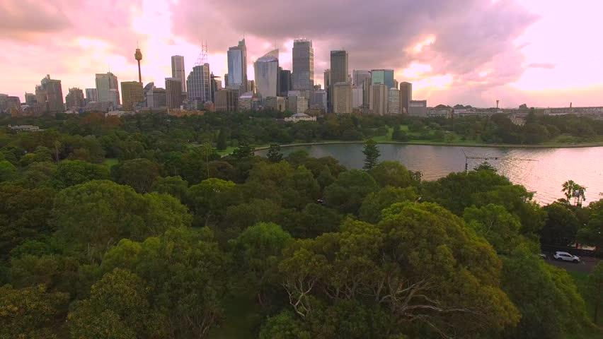 Aerial flight over Sydney Australia skyline in 4 K during sunset