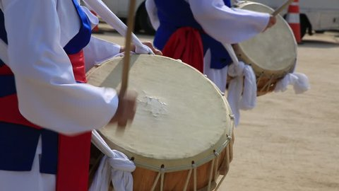 Performers playing traditional Korean music, the nongak, also known as the farmers' music at Yeouido cherry blossom festival in Seoul, South Korea