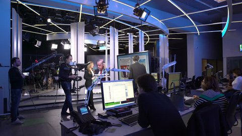 MOSCOW, RUSSIA - APRIL 10, 2016: Live with two newscaster in the studio of international TV channel.