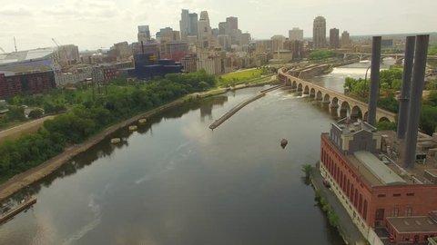4k Aerial Drone Video over The Minneapolis, Minnesota Skyline and The Stone Arch Bridge