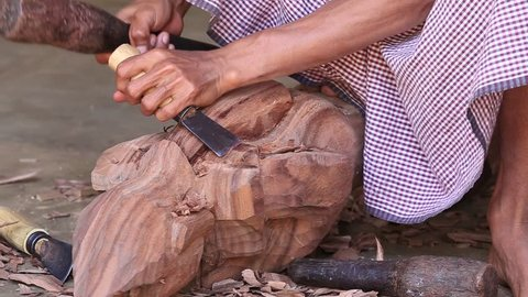 Burmese man are making wooden souvenirs for tourists in Bagan, Myanmar. Wood Carving is a traditional handicraft in Myanmar