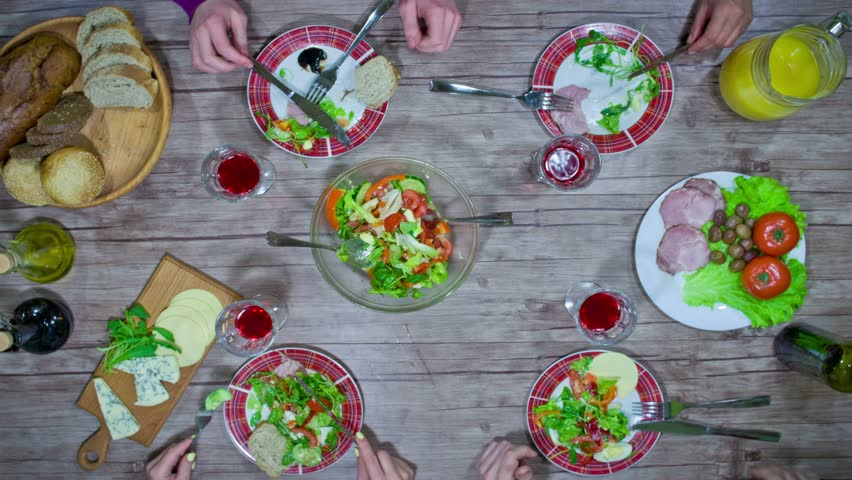 Eating salad with friends - stop motion animation, 4K, top view