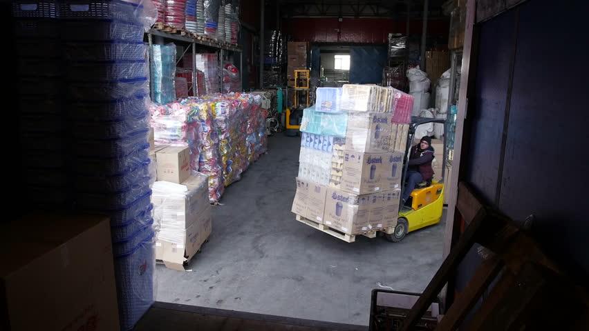Forklift truck loading a truck