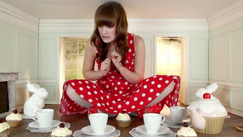 November 12, 2010: Young woman eating cupcake in small house
