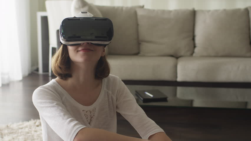 Woman Wearing VR Headset in Living Room. Shot on RED Cinema Camera.