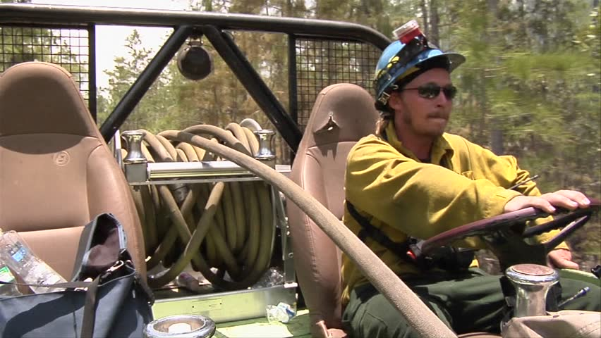 EVERGLADES, FL - CIRCA 2009: Firefighters drive a swamp buggy fire truck during  a prescribed fire circa 2009 in the Everglades.