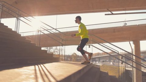 Jogging on a big bridge.