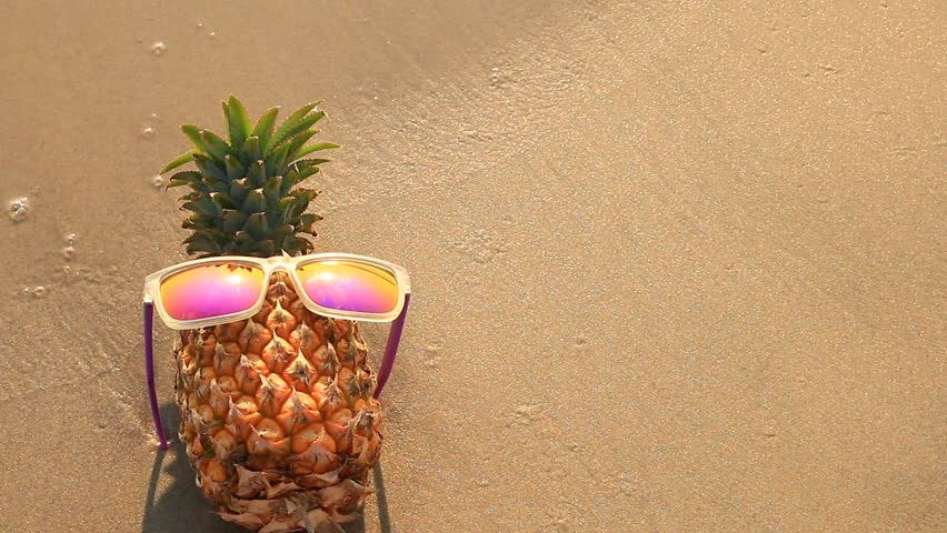 Pineapple At The Beach: Pineapple In Sunglasses On Sand Beach. Stock Footage Video