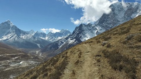 A POV video of an hiker walking from Dingboche toward the village of Dzonglha, the base to cross the Cho La pass that link Gokyo with the Everest valley in the Himalayas in Nepal