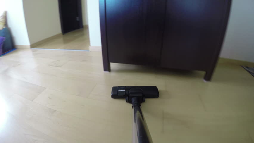 Man Hands With Vacuum Cleaner Tool Hoover Dust On Wooden Floor Under Cabinet.  Household Works. Professional Staff Cleaning House. Camera Mounted On  Hoover.