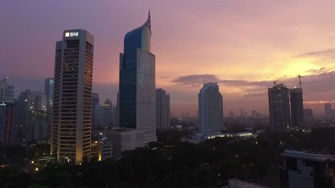 JAKARTA, INDONESIA - APRIL 15, 2016: A panned view of Jakarta business district along the city main avenue, Jalan Sudirman, which is lined with many banks HQ and other office towers.
