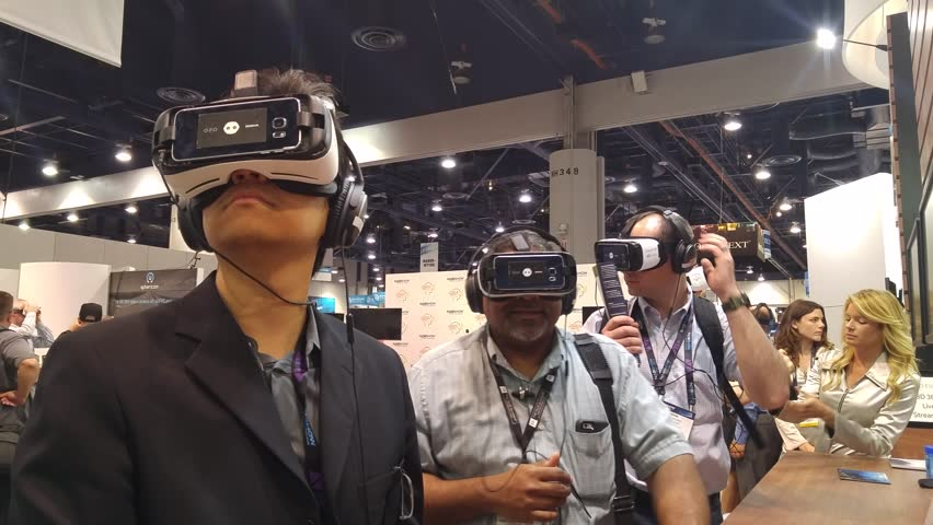 LAS VEGAS - April 20, 2016: Business people experiencing 360 Virtual Reality in VR headsets at NOKIA OZO booth at NAB 2016, an annual trade show by in Las Vegas Convention Center