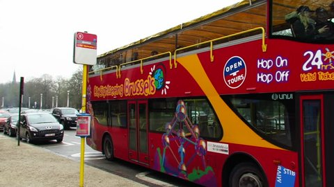 Brussels, Belgium - winter 2016. City Sightseeing Brussels Hop-On Hop-Off bus. The Atomium line B bus stop at Brussels Central Station.