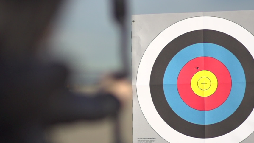 A female archer shooting targets with her bow and arrow. - Slow Motion - Model Released - filmed at 480 fps   Shutterstock HD Video #16073335