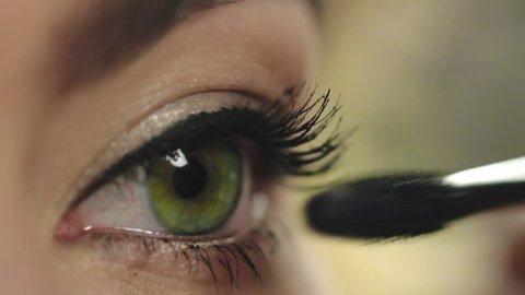 Make up stylist uses mascara for painting lashes