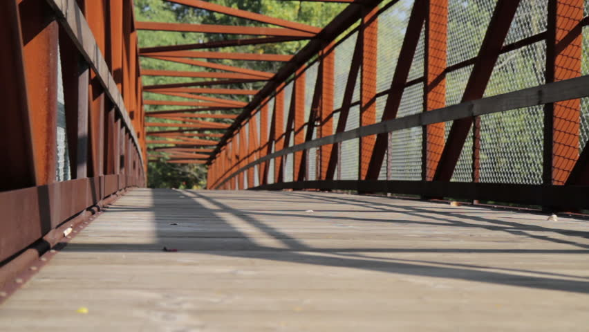 Runner on Bridge - dolly shot
