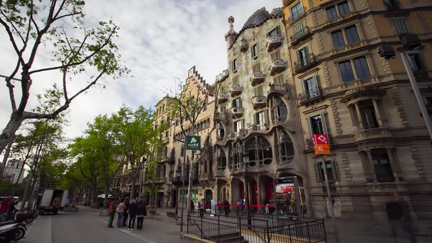 Barcelona, Spain - April 9, 2016: Hyperlapse of the facades of Casa Batllo and Casa Amatller, in Passeig de Gracia, two modernist buildings designed by Antoni Gaudi and Josep Puig i Cadafalch.