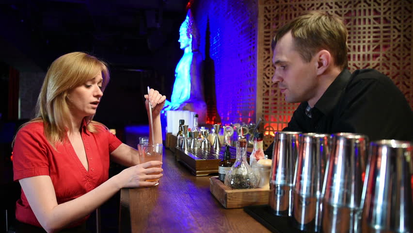Sad girl crying at the bar. drinks cocktails, night time. girl complains to the bartender   Shutterstock HD Video #16118035