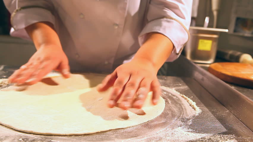 rolling dough of pizza