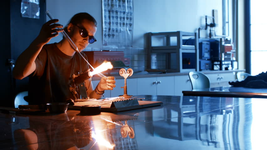 Working Glass Tube - Pulling a thread with the torch   Shutterstock HD Video #16137355
