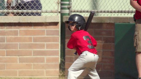 A boy at bat while playing little league baseball. - Super Slow Motion - Model Released - filmed at 240 fps
