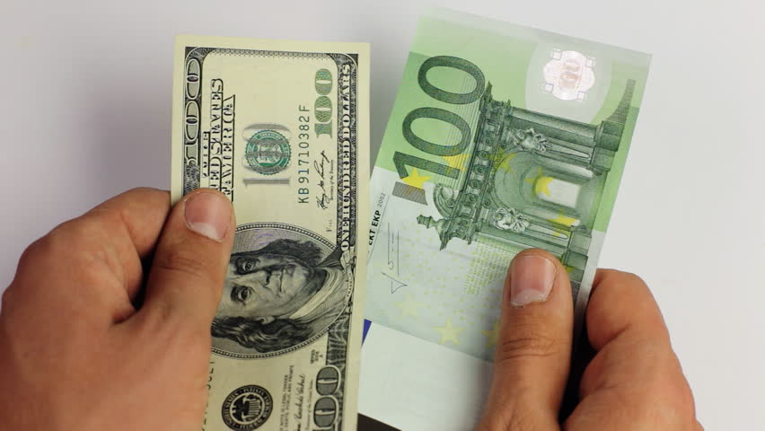 Choosing Between Us Dollar And Euro Banknote