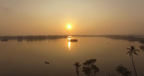 Aerial sloe moving shot over backwaters at sunrise in India