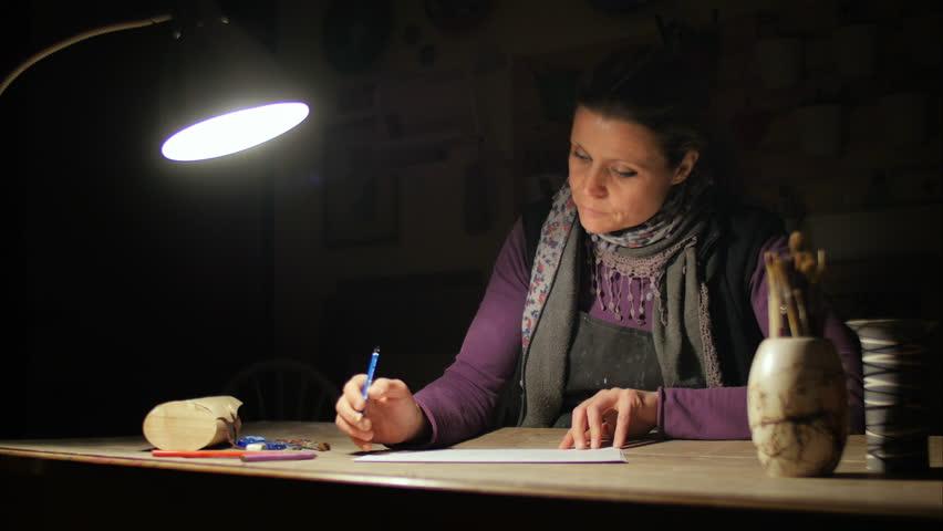 Ceramic maker designing artwork with pencil in her atelier | Shutterstock HD Video #16183045