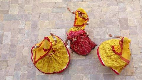 India, Rajasthan, Jaipur, Samode Palace, women wearing colourful Saris dancing - Model and Property released