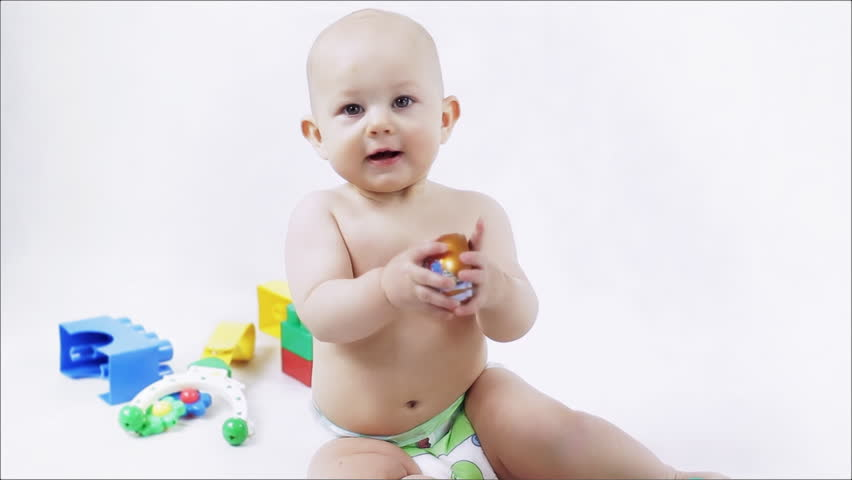 Little smiling baby. Child playing with color blocks. Delightful little baby smiling. Space for title. Canon 7d, HD 1080 25p Clip ID: Baby2_HD