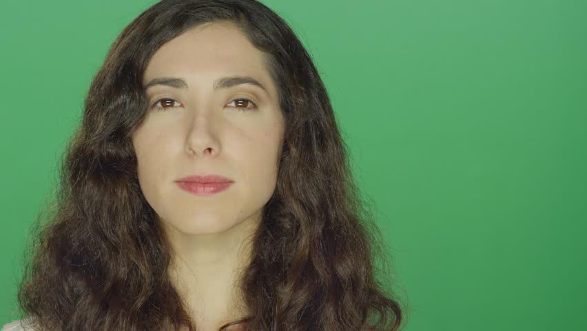 Young brunette woman, on a green screen studio background | Shutterstock HD Video #16253455