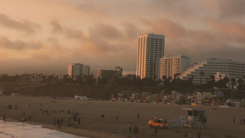 Slow moving clouds at sunset over California Beach | Shutterstock HD Video #16266745