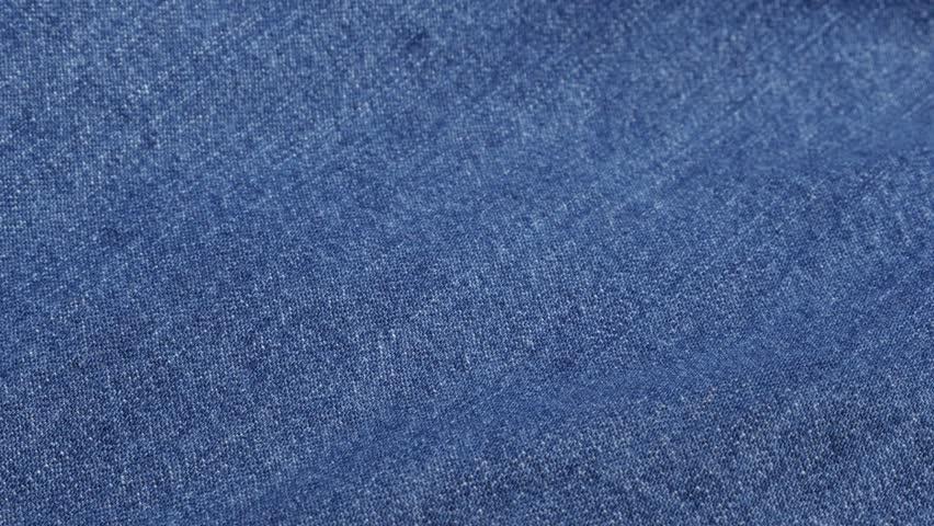 f800d691e7f Dark blue denim fabric details and texture close-up tilting 4K 2160p 30fps  UltraHD video - Jeans dugaree cloth in blue color gathers slow tilt 4K  3840X2160 ...