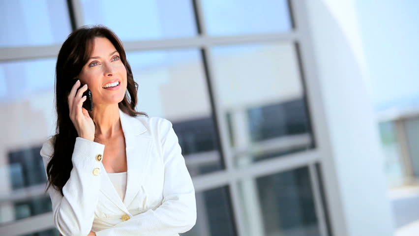 Female Caucasian Business Executive with Smartphone | Shutterstock HD Video #1630525