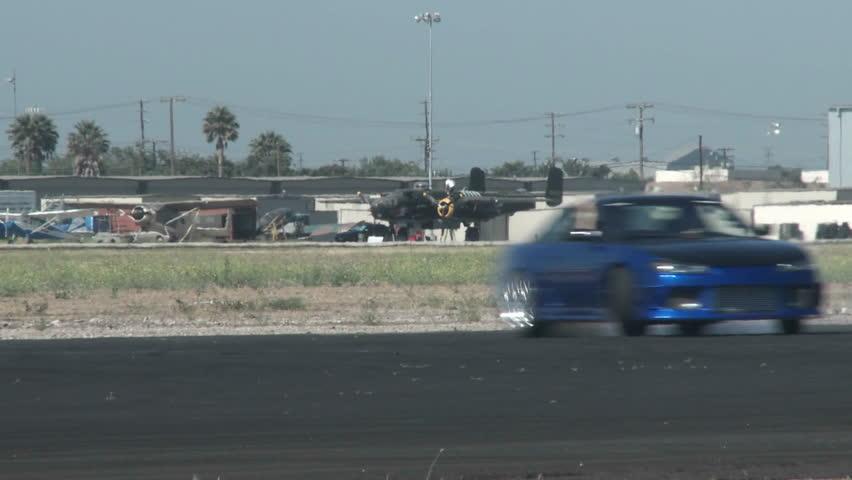 A blue car glides through a drifting course at Camarillo Airport in Camarillo California.