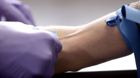 Phlebotomist Draws Blood from a Patient Closeup
