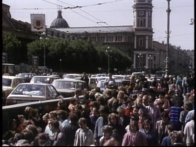 MOSCOW, RUSSIA - CIRCA 1970: Crowds mill on the streets of the old Soviet Union in this archival shot.