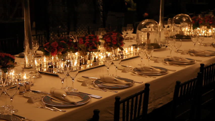 elegant candlelight dinner table setting at reception stock