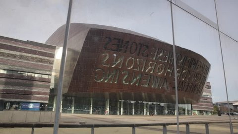 CARDIFF, SOUTH GLAMORGAN, UK- APRIL 30, 2016. 180 degree pan from mirror of exterior of the Wales Millennium Centre, an arts centre in the Cardiff Bay area, home of the Welsh National Opera