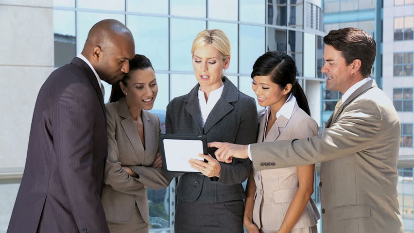 Ambitious Business Executives Using Wireless Tablet | Shutterstock HD Video #1638214