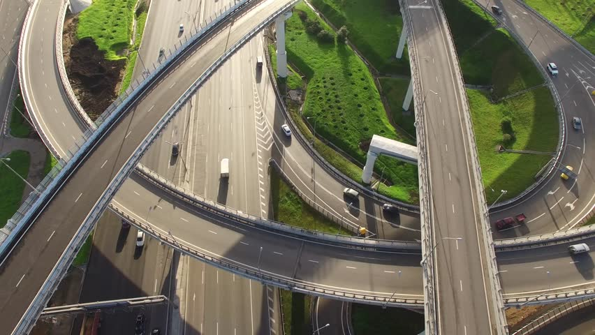 Unique flyover the complex road junction. Closeup. Sunny day, sunset. Modern Russia. Moscow aerial high altitude drone flight. Ultrahd 4K.