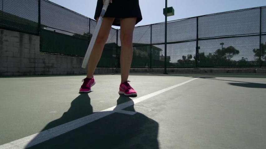 Women playing tennis. - Slow Motion - Model Released - filmed at 59.94 fps - Clip is HD 1920 x 1080