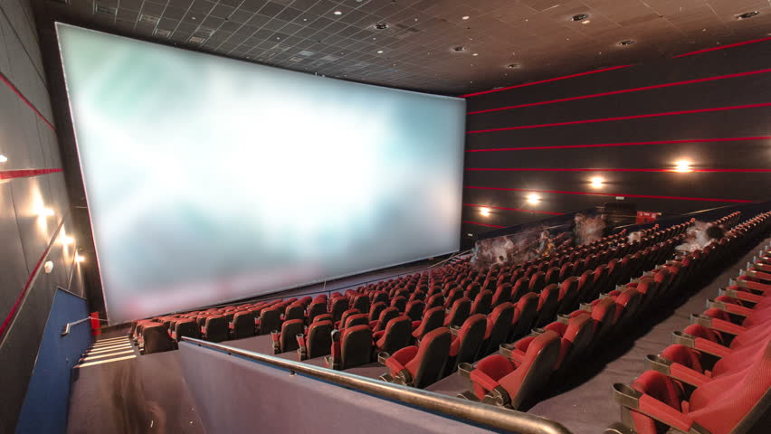 viewers watch motion picture at movie theatre timelapse