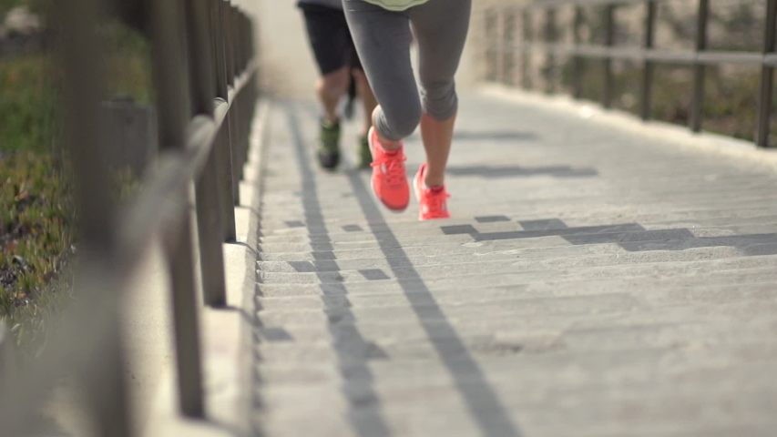 A woman running stairs. - Super Slow Motion - Model Released - filmed at 240 fps - Clip is HD 1920 x 1080