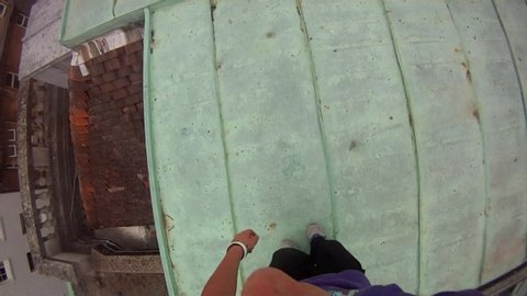 POV of young men doing a parkour freerunning jumping and flipping stunt. - Model Released - HD - Clip is HD 1920 x 1080