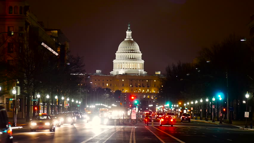 WASHINGTON DC, USA - 3 FEB 2014: View of United States Capitol Building at night with vehicles passing