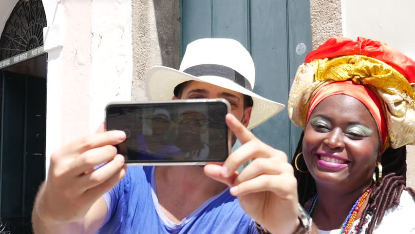 Tourist taking a selfie with a Baiana in the old colonial district of Salvador, Brazil | Shutterstock HD Video #16414675