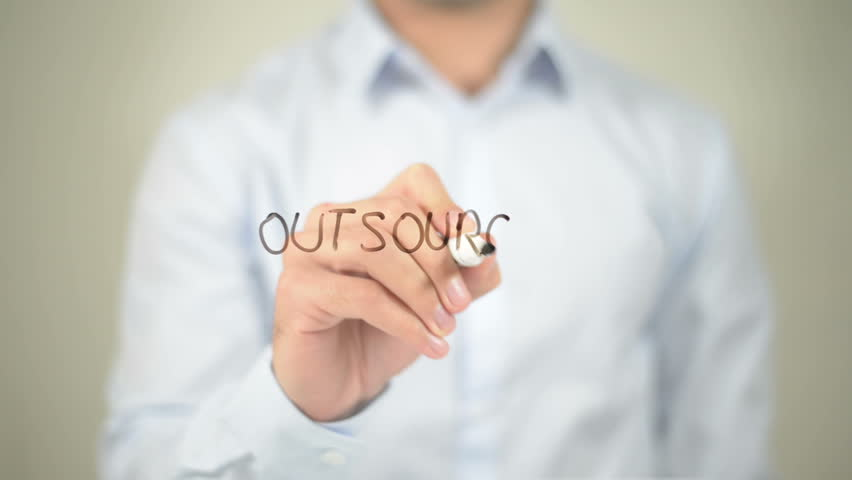 Outsourcing , man writing on transparent screen