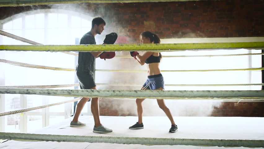 Man woman training gym boxing mma ring pads mixed martial arts man woman training gym boxing mma ring pads mixed martial arts fitness hd stock video altavistaventures Choice Image